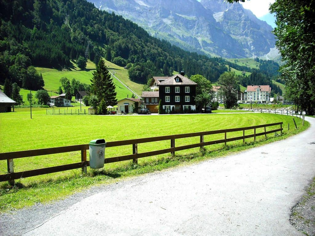 driving on road in swiss village in summer
