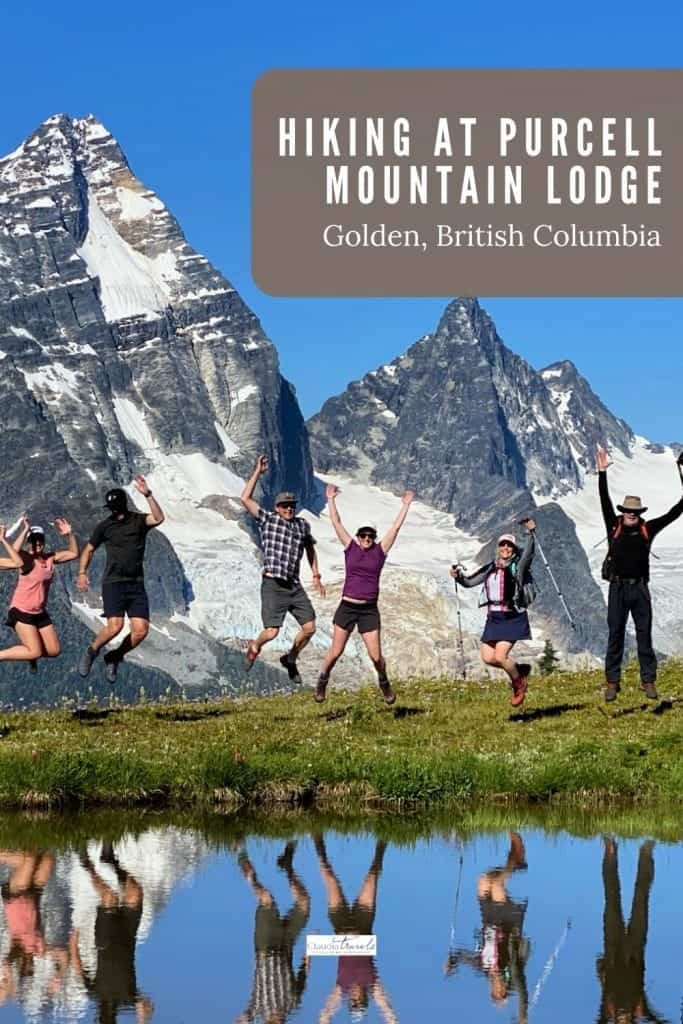 hikers jumping in front of mountains at purcell mountain lodge