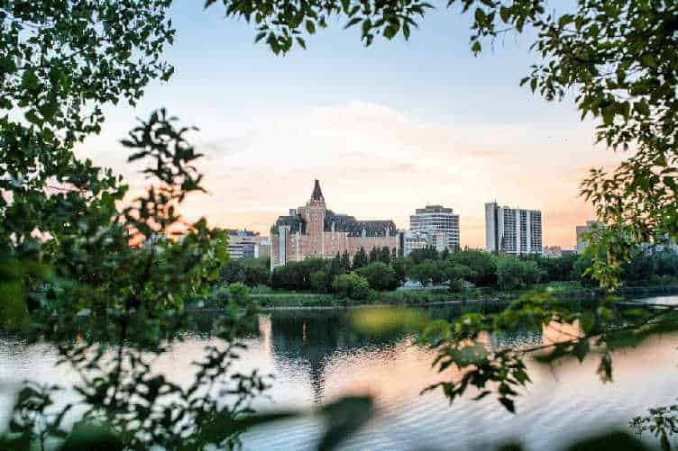 downtown saskatoon through the trees at sunset