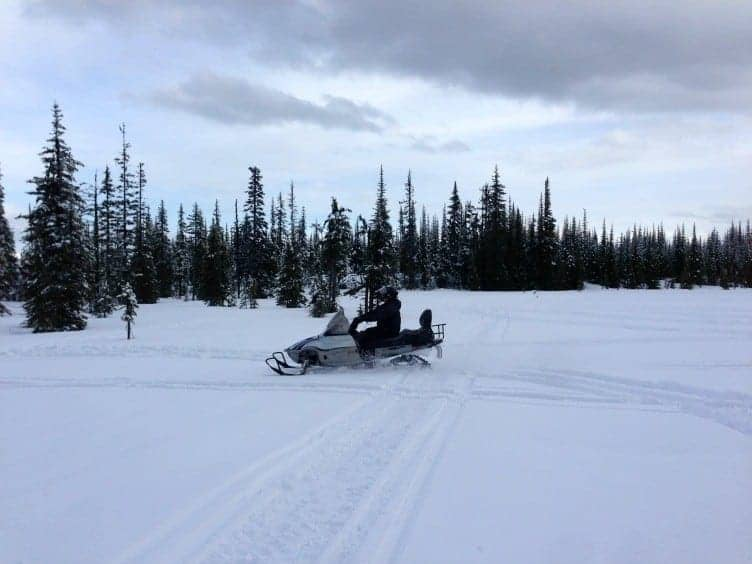 Embrace the spirit of winter adventure by snowmobiling at Sun Peaks Resort in the champagne powder of Canada's second largest ski resort. | thetravellingmom.ca
