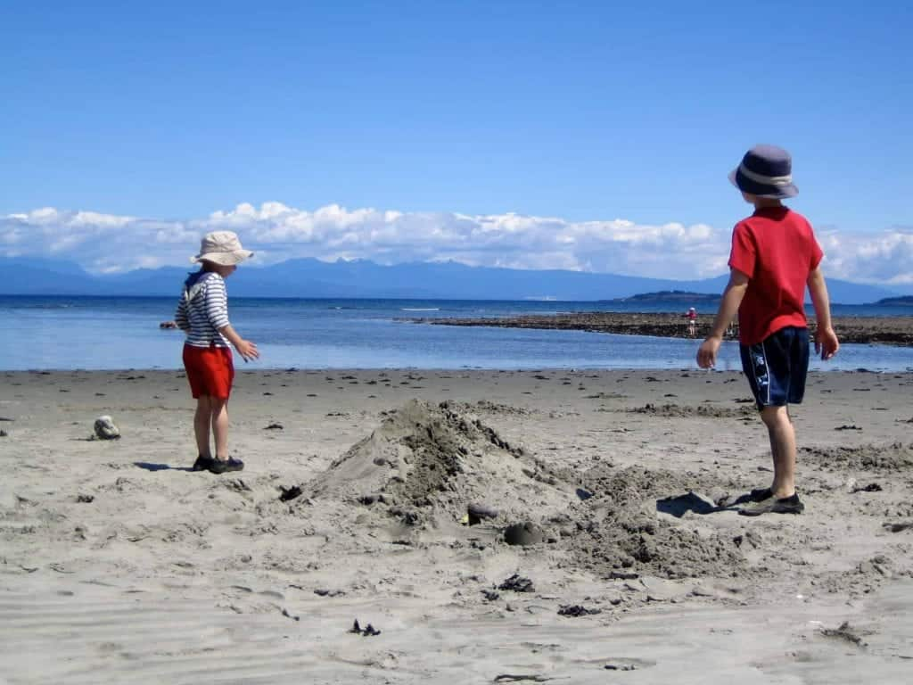 young boys building sandcastles on parksville beach