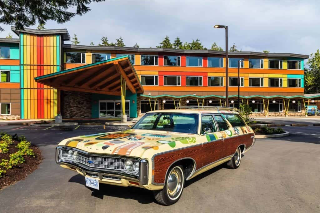 old car in front of colorful hotel zed tofino
