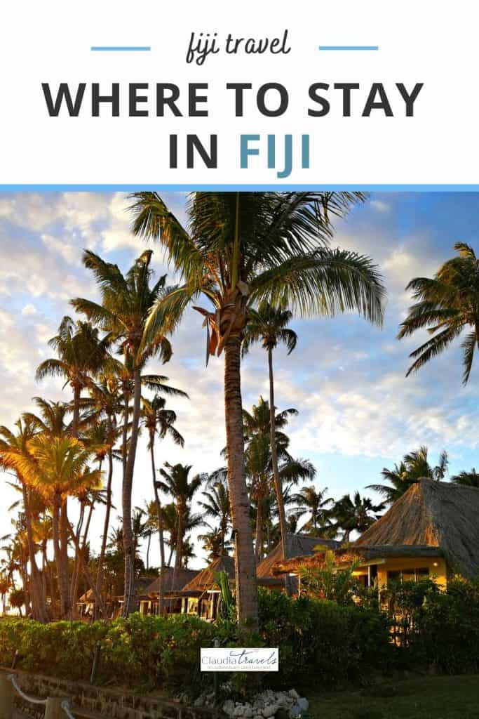 palm trees and bures in fiji