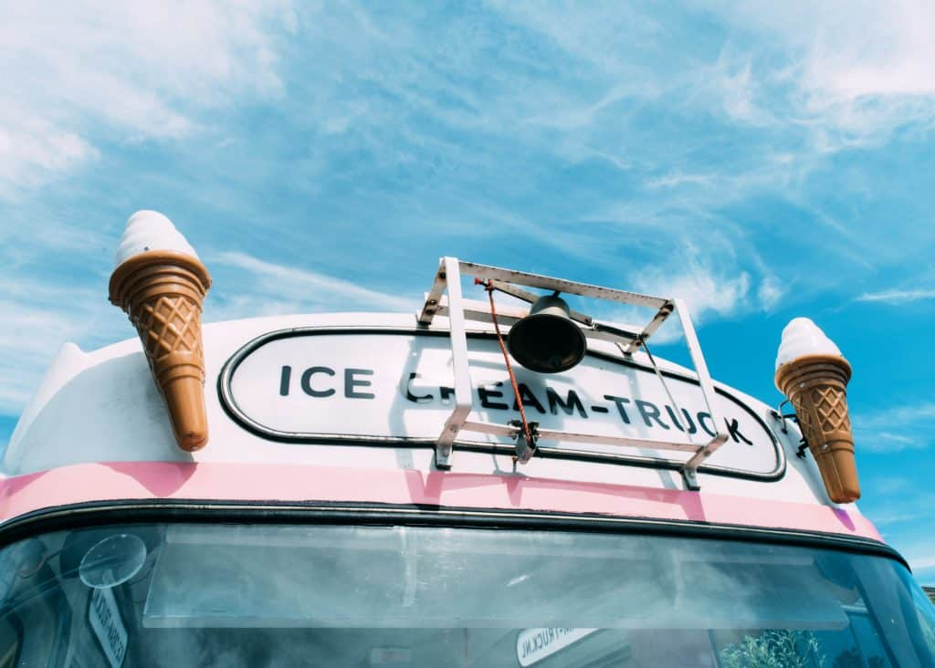 ice cream truck with scoops on front